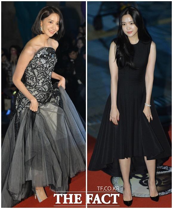 少女時代のユナ(左)とApinkのナウンが25日、ソウルで開かれた第54回大鐘賞映画祭授賞式に出席し、レッドカーペットを歩いた。|イ・ドクイン記者