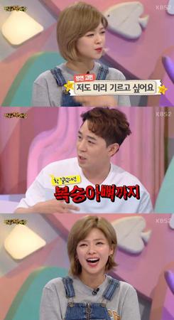 韓国ガールズグループ「TWICE」メンバーのジョンヨンが、髪の長さで悩んでいることを明らかにした。(提供:OSEN)