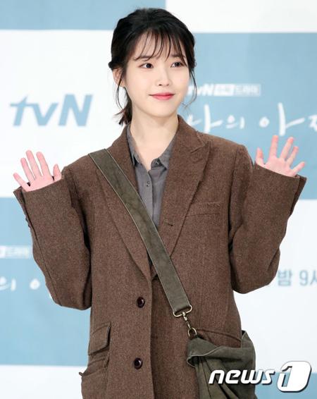 """韓国歌手兼女優IU(アイユー)が一部の悪質な書き込み者を対象に刑事告訴状を提出し、""""強硬対応""""を予告した。(提供:news1)"""