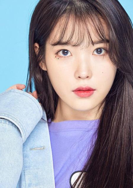 韓国歌手IU(アイユー)が現所属事務所のkakaoM(カカオM/旧LOENエンターテインメント)との10年の義理を守った。(提供:OSEN)