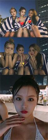 「MOMOLAND」、プールで反転した魅力を発散…セクシー美に視線集中(提供:news1)