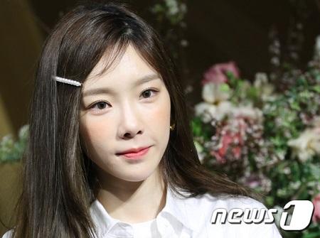 韓国ガールズグループ「少女時代」テヨンが、新曲「四季(Four Seasons)」で1位を続けている。(提供:news1)